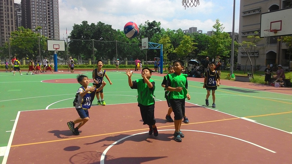 Basketball requires teamwork, which can lead to enhanced cooperation skills off the court too.